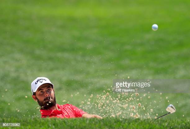 Curtis Luck of Australia plays a shot from a bunker on the first hole during the final round of the Quicken Loans National on July 2 2017 TPC Potomac...