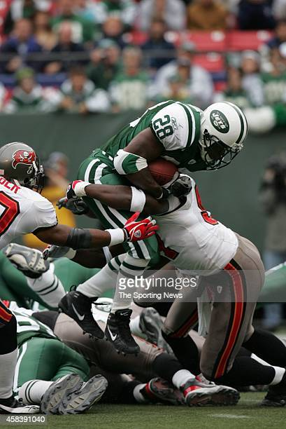 Curtis Martin of the New York Jets runs through the tackle during a game against the Tampa Bay Buccaneers on October 09 2005 at the Meadowlands...