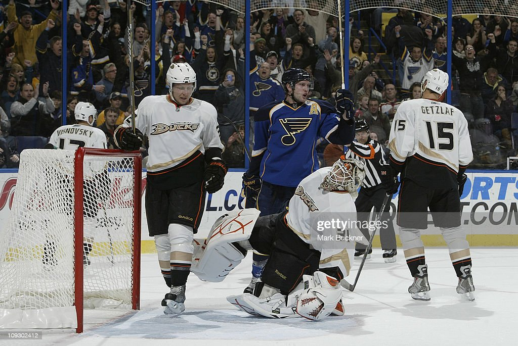 Curtis McElhinney #31 of the Anaheim Ducks reacts after giving up a goal to <a gi-track='captionPersonalityLinkClicked' href=/galleries/search?phrase=Andy+McDonald+-+Ice+Hockey+Player&family=editorial&specificpeople=206576 ng-click='$event.stopPropagation()'>Andy McDonald</a> #10 of the St. Louis Blues as <a gi-track='captionPersonalityLinkClicked' href=/galleries/search?phrase=David+Backes&family=editorial&specificpeople=2538492 ng-click='$event.stopPropagation()'>David Backes</a> #42 of the St. Louis Blues celebrates for his teammate in an NHL game on February 19, 2011 at Scottrade Center in St. Louis, Missouri.