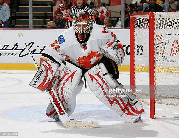 Curtis McElhinney of the Calgary Flames focuses on the play during the NHL game against the Detroit Red Wings on November 27 2007 at Joe Louis Arena...
