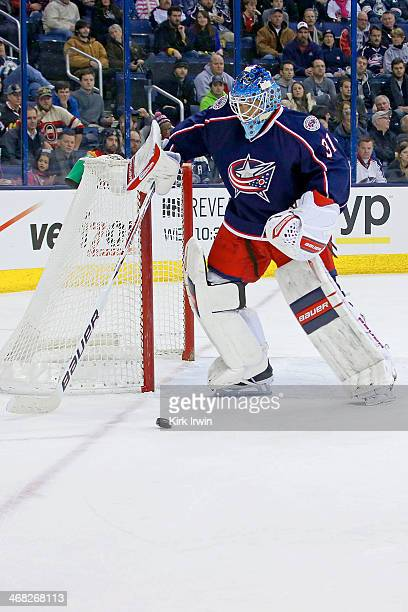 Curtis McElhinney of the Columbus Blue Jackets controls the puck during the game against the Ottawa Senators on January 28 2014 at Nationwide Arena...