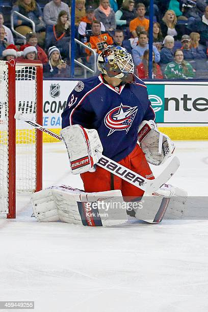 Curtis McElhinney of the Columbus Blue Jackets follows the puck during the game against the Philadelphia Flyers on December 21 2013 at Nationwide...