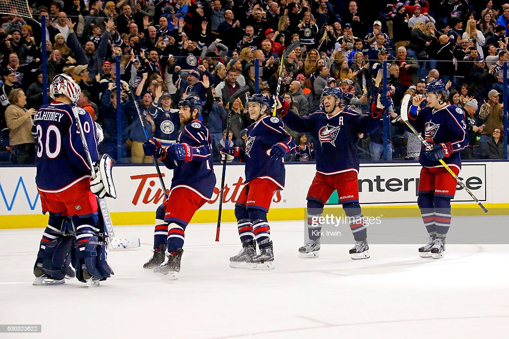 Curtis McElhinney #30 of the Columbus Blue Jackets is congratulated by his teammates after defeating the Los Angeles Kings 3-2 in a shootout on December 20, 2016 at Nationwide Arena in Columbus, Ohio.