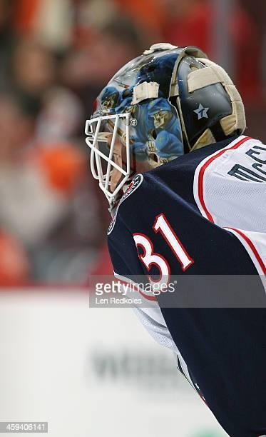 Curtis McElhinney of the Columbus Blue Jackets looks on against the Philadelphia Flyers on December 19 2013 at the Wells Fargo Center in Philadelphia...
