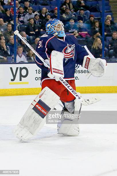 Curtis McElhinney of the Columbus Blue Jackets makes a save during the game against the Ottawa Senators on January 28 2014 at Nationwide Arena in...