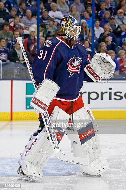 Curtis McElhinney of the Columbus Blue Jackets prepares for a faceoff during the game against the Vancouver Canucks on October 20 2013 at Nationwide...