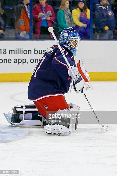 Curtis McElhinney of the Columbus Blue Jackets warms up prior to the start of the game against the Ottawa Senators on January 28 2014 at Nationwide...