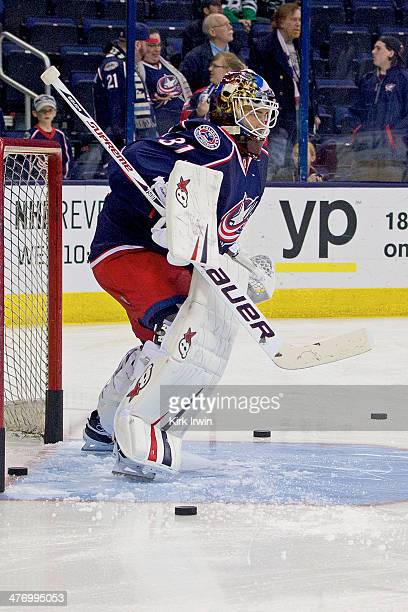 Curtis McElhinney of the Columbus Blue Jackets warms up prior to the start of the game against the Dallas Stars on March 4 2014 at Nationwide Arena...