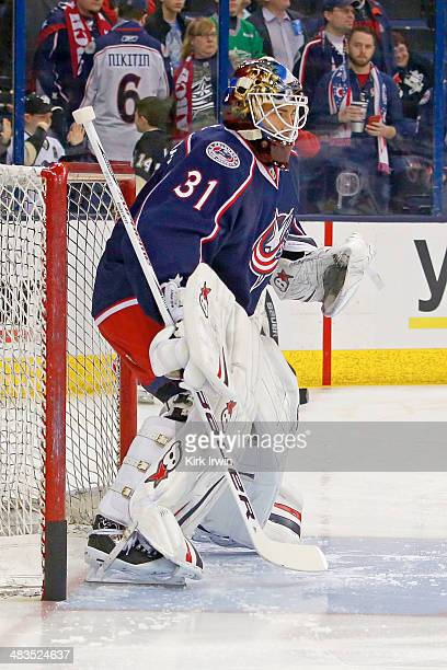 Curtis McElhinney of the Columbus Blue Jackets warms up prior to the start of the game against the Pittsburgh Penguins on March 28 2014 at Nationwide...
