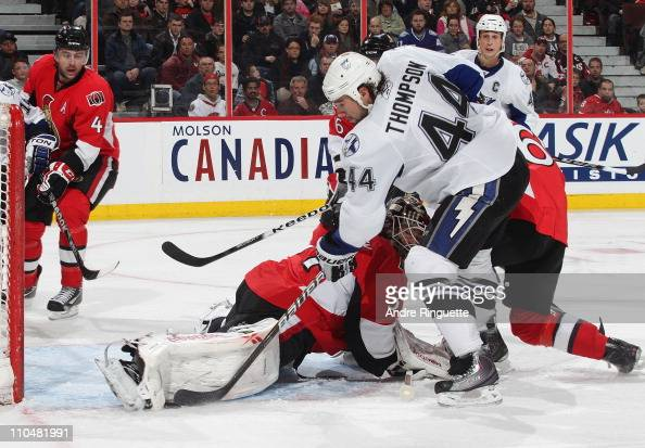 Curtis McElhinney of the Ottawa Senators makes a toes save against Nate Thompson of the Tampa Bay Lightning at Scotiabank Place on March 19 2011 in...