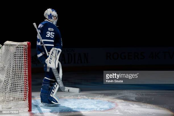 Curtis McElhinney of the Toronto Maple Leafs during pregame ceremonies prior to an NHL game against the Florida Panthers at the Air Canada Centre on...