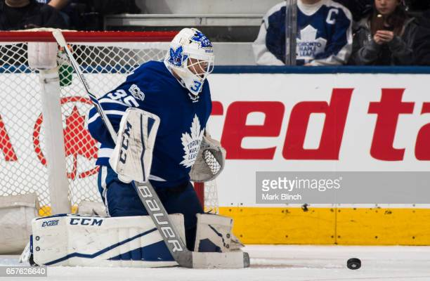 Curtis McElhinney of the Toronto Maple Leafs makes a save against the New Jersey Devils during the third period at the Air Canada Centre on March 23...