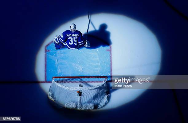 Curtis McElhinney of the Toronto Maple Leafs skates in the spotlight prior to the game against the New Jersey Devils at the Air Canada Centre on...