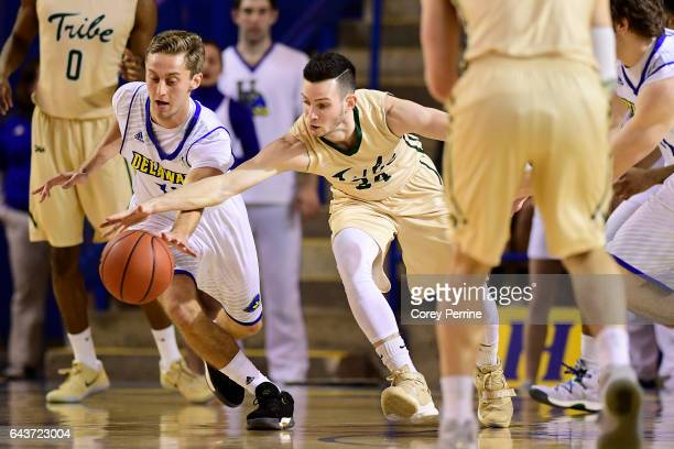 Curtis McRoy of the Delaware Fightin Blue Hens and David Cohn of the William Mary Tribe vie for a loose ball during the first half at the Bob...
