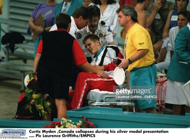 Curtis Myden Canada collapses during his silver medal presentation