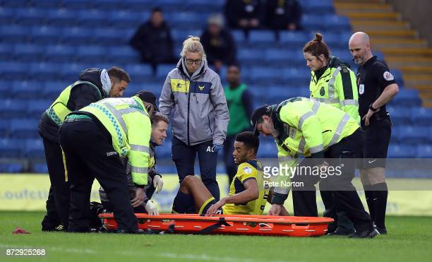 Curtis Nelson of Oxford United is help onto a stretcher during the Sky Bet League One match between Oxford United and Northampton Town at Kassam...