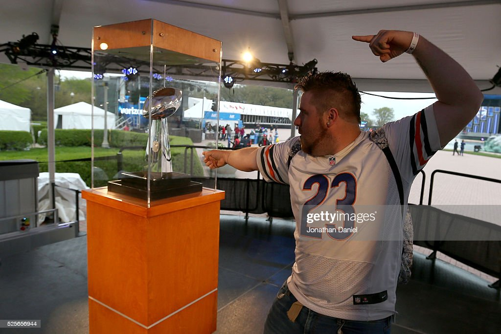 Curtis Norwood of Chicago, IL poses with the Vince Lombardi Trophy at the Draft Town prior to the 2016 NFL Draft at Grant Park on April 28, 2016 in Chicago, Illinois.