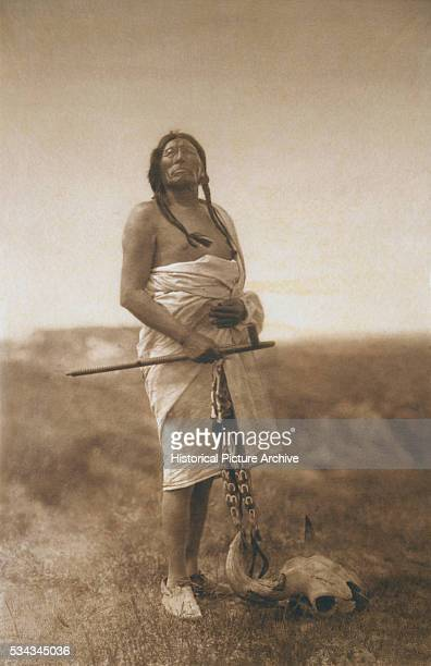 'Curtis' notes Invocation and supplication enter so much into the life of the Indian that this picture of the grim old warrior invoking the Mysteries...