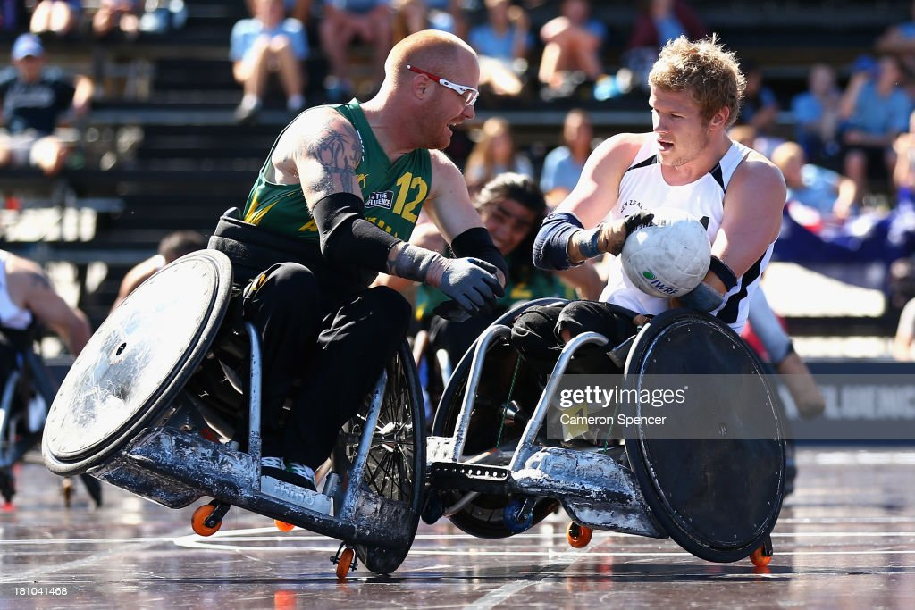 Curtis Palmer of Australia tackles <a gi-track='captionPersonalityLinkClicked' href=/galleries/search?phrase=Cameron+Leslie&family=editorial&specificpeople=5525988 ng-click='$event.stopPropagation()'>Cameron Leslie</a> of New Zealand during the Wheelchair Rugby Tri-Nations match between Australia and New Zealand on September 19, 2013 in Sydney, Australia.