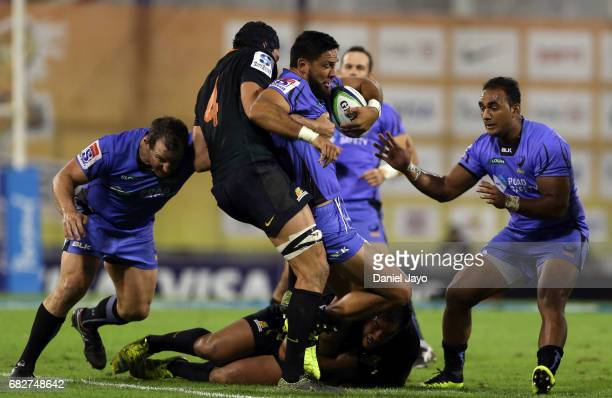 Curtis Rona is tackled by Guido Petti Pagadizabal of Jaguares during a match between Jaguares v Force as part of Super Rugby Rd 12 at Jose Amalfitani...