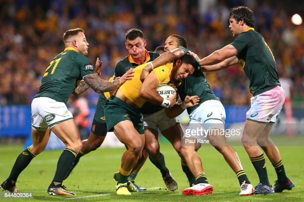 Curtis Rona of Australia gets tackled during The Rugby Championship match between the Australian Wallabies and the South Africa Springboks at nib...
