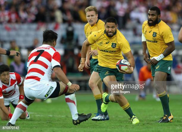 Curtis Rona of Australia runs with the ball during the rugby union international match between Japan and Australia Wallabies at Nissan Stadium on...