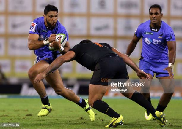 Curtis Rona of Force is challenged by Santiago Garcia Botta of Jaguares during a match between Jaguares v Force as part of Super Rugby Rd 12 at Jose...