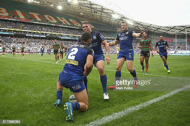 Curtis Rona of the Bulldogs celebrates with his team mates Adam Elliott and Josh Morris of the Bulldogs after scoring a try during the round four NRL...
