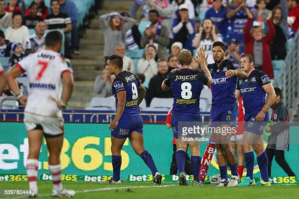 Curtis Rona of the Bulldogs celebrates with his team mates after scoring a try during the round 14 NRL match between the St George Illawarra Dragons...