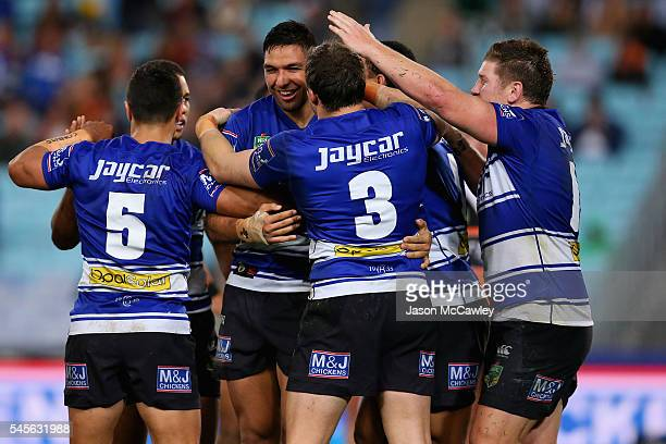 Curtis Rona of the Bulldogs celebrates with teammates after scoring a try during the round 18 NRL match between the Canterbury Bulldogs and the Wests...