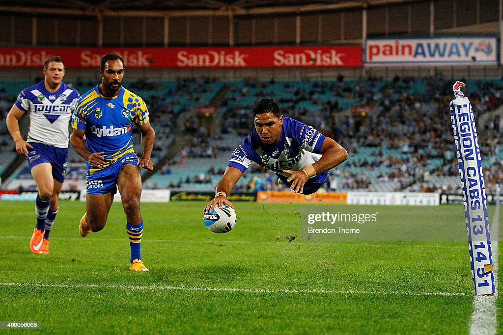 Curtis Rona of the Bulldogs dives into the corner to score the opening try during the round two NRL match between the Canterbury Bulldogs and the...