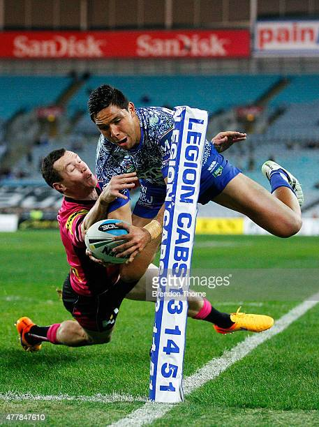 Curtis Rona of the Bulldogs dives over to score a try during the round 15 NRL match between the Canterbury Bulldogs and the Penrith Panthers at ANZ...