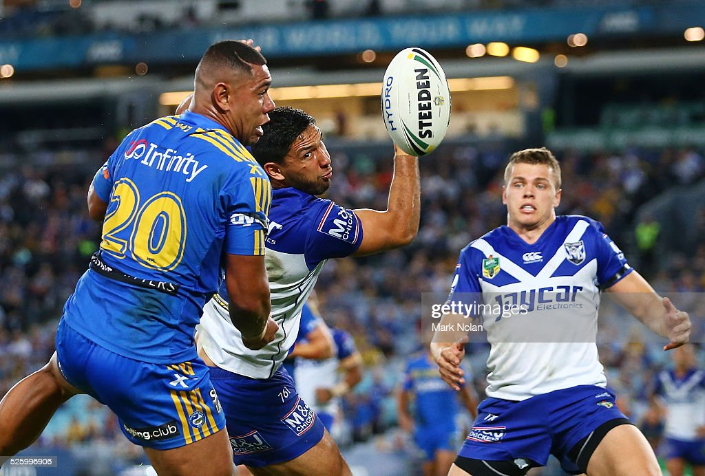 Curtis Rona of the Bulldogs drops a high ball and allows Vai Afu Toutai of the Eels to score during the round nine NRL match between the Parramatta Eels and the Canterbury Bulldogs at ANZ Stadium on April 29, 2016 in Sydney, Australia.