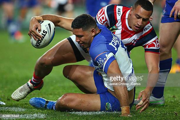 Curtis Rona of the Bulldogs is tackled by the Rooster's Sam Moa during the Semi Final 1 match between the Sydney Roosters and the Canterbury...