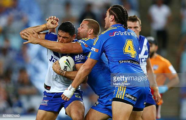 Curtis Rona of the Bulldogs is tackled during the round nine NRL match between the Parramatta Eels and the Canterbury Bulldogs at ANZ Stadium on...