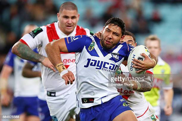 Curtis Rona of the Bulldogs runs the ball during the round 21 NRL match between the Canterbury Bulldogs and the St George Illawarra Dragons at ANZ...