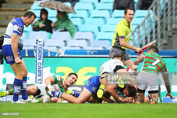 Curtis Rona of the Bulldogs scores the opening try during the round five NRL match between the Canterbury Bulldogs and the South Sydney Rabbitohs at...