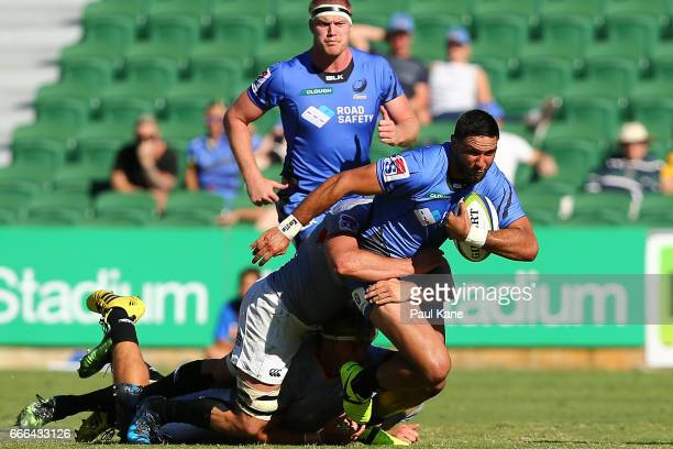 Curtis Rona of the Force attempts to break from a tackle during the round seven Super Rugby match between the Force and the Kings at nib Stadium on...