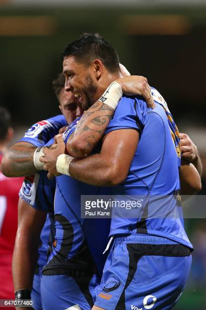 Curtis Rona of the Force is congratulated by team mates after crossing for a try during the round two Super Rugby match between the Western Force and...