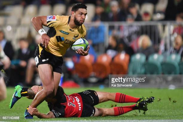 Curtis Rona of the Force is tackled by Tim Bateman of the Crusaders during the round five Super Rugby match between the Crusaders and the Force at...