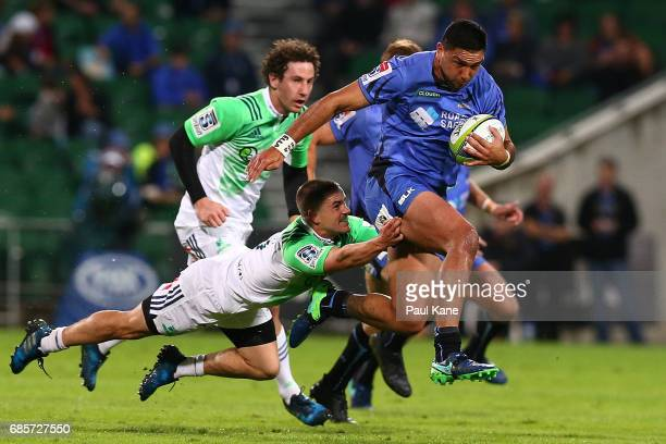Curtis Rona of the Force slips a tackle by Kayne Hammington of the Highlanders during the round 13 Super Rugby match between the Force and the...