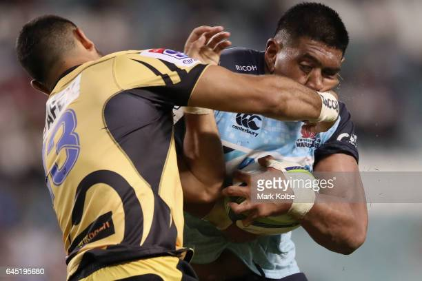 Curtis Rona of the Force tackles Will Skelton of the Waratahs during the round one Super Rugby match between the Waratahs and the Force at Allianz...