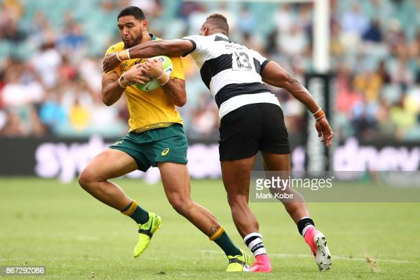 Curtis Rona of the Wallabies is tackled Thomas Banks of the Barbarians during the match between the Australian Wallabies and the Barbarians at...
