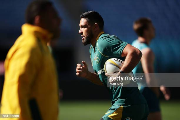 Curtis Rona of the Wallabies runs with the ball during the Australian Wallabies Captain's Run at ANZ Stadium on August 18 2017 in Sydney Australia