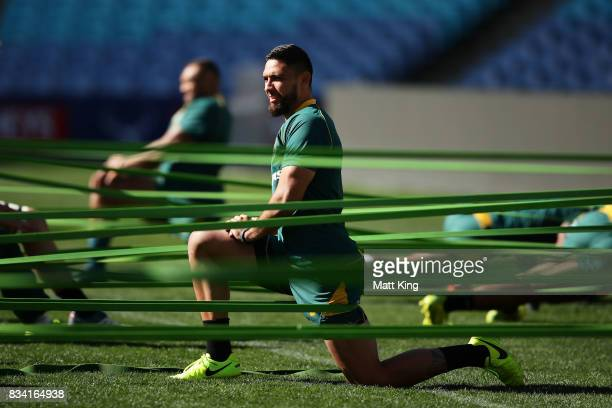 Curtis Rona of the Wallabies stretches during the Australian Wallabies Captain's Run at ANZ Stadium on August 18 2017 in Sydney Australia
