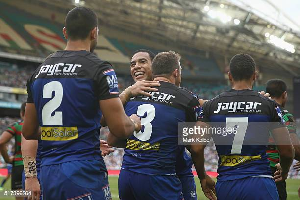 Curtis Rona Will Hopoate Josh Morris and Moses Mbye of the Bulldogs celebrate Curtis Rona scoring a try during the round four NRL match between the...
