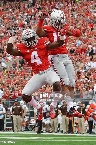 Curtis Samuel and Jalin Marshall of the Ohio State Buckeyes celebrate Marshall's second quarter touchdown against the Western Michigan Broncos at...