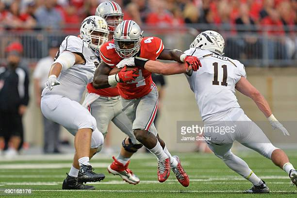 Curtis Samuel of the Ohio State Buckeyes breaks through the tackle of Devon Brant of the Western Michigan Broncos en route to a 40yard touchdown run...