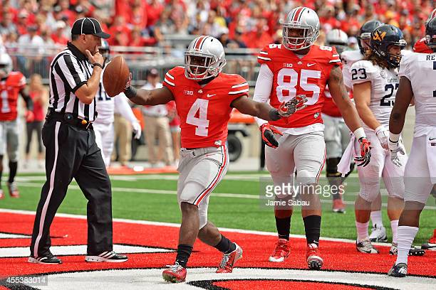 Curtis Samuel of the Ohio State Buckeyes celebrates a third quarter touchdown against the Kent State Golden Flashes at Ohio Stadium on September 13...