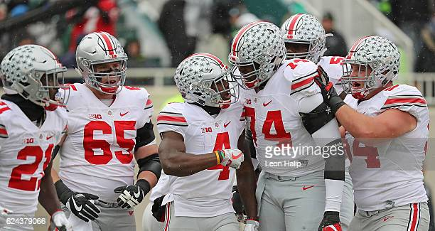 Curtis Samuel of the Ohio State Buckeyes celebrates a touchdown with his teammates during the first quarter of the game against the Michigan State...